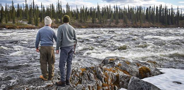 Dunn and Cleason scouting frigid rapids near the Arctic Circle. Photo by Jane Allen