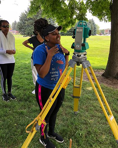 Betty working with a total station