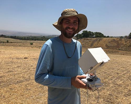 Logan flies a UAV