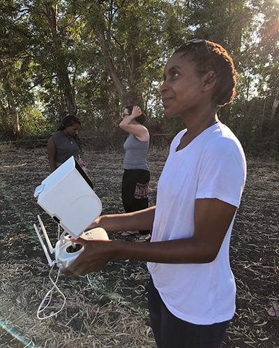 Larissa flying a UAV