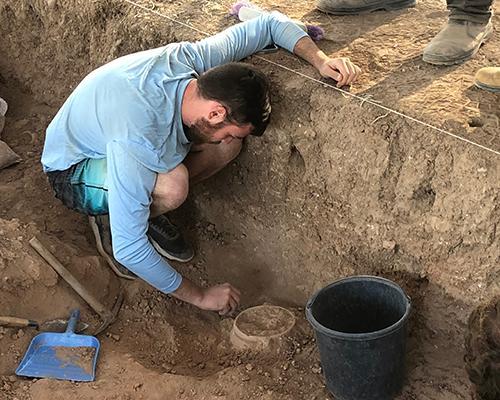 Logan digging at Tell es Safi