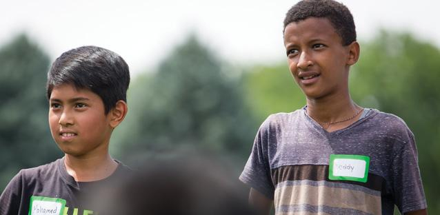 Soccer Without Borders athletes, including Mohamed (left) and Teddy, participate in a deep cross-cultural experience every time they step on the field. All of the players speak at least English and their native language, at varying levels.