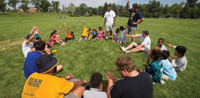 A key feature of Soccer Without Borders is community — a key part of which takes place in a circle each practice, when coaches work on team-related concepts and provide a space for youth to have their voices heard. The UNC athletes, likewise, circled up with the students during their summer field days.