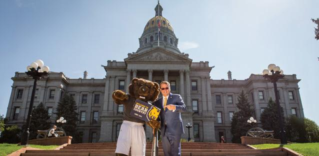 Andy's tour stop in Denver included the steps of the Capitol with mascot Klawz. He's frequently in Denver to represent UNC. Photo by Woody Myers