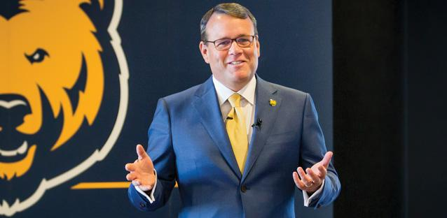 Among the first-year president's priorities is meeting with the university community. Andy is pictured here presenting to alumni and friends in Denver. Photo by Woody Myers