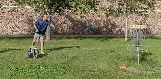 """Andy's interests include playing disc golf. """"When I got here, I joined a group of students for a round on the nine-hole course,"""" he says. Photo by Hunter Wilson"""