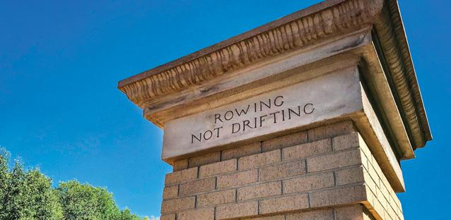 "'Rowing Not Drifting' is inscribed on the 10th Avenue Horace Mann Gate, a gift from the Class of 1910. Andy appreciates the sentiment and history attached to the gate, and sees the motto as a metaphor for the teamwork needed to advance the university. ""We need to be intentional and collaborate to achieve a common goal,"" he says. Photo by Hunter Smith"