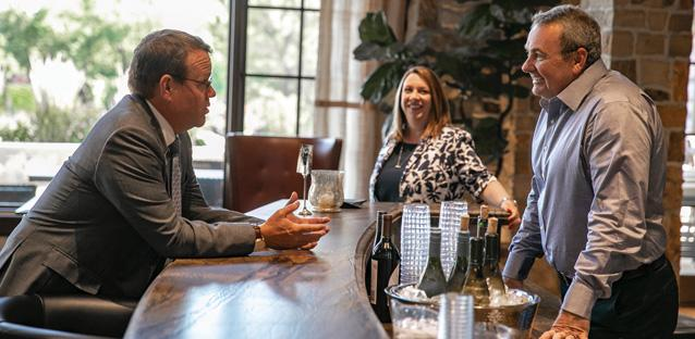 One of Andy's priorities is the successful conclusion of the Campaign for UNC. In August he met with campaign donors at an event hosted by alumni John '84, pictured, and Angela '89 Schmidt. Photo by Hunter Wilson