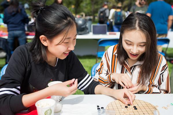 Students playing chinese checkers