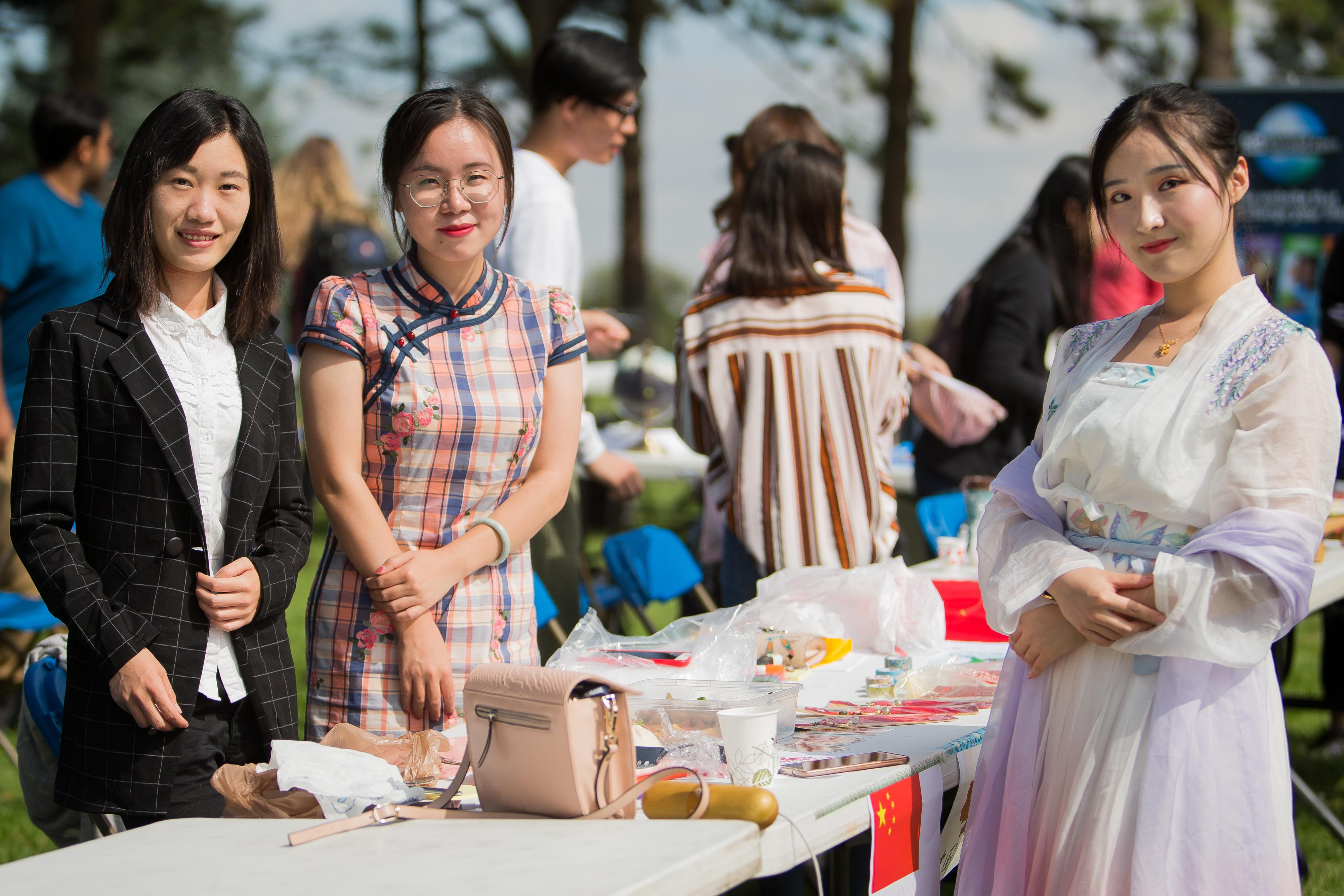 Asian exchange students attending the fair