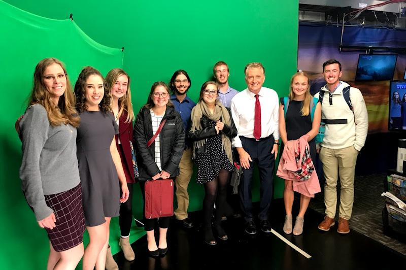 Posing with chief meteorologist, Mike Nelson, in front of the Denver7 green screen