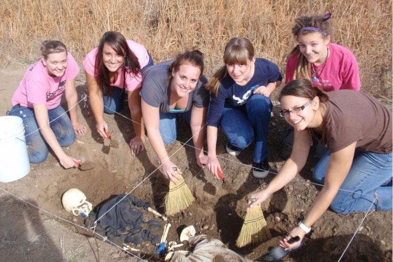 UNC Forensic Anthropology students excavate a mock skeleton at the Poudre Learning Center.