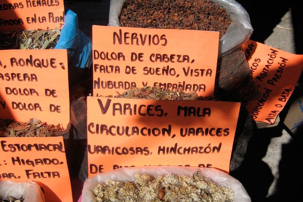 Herbs used to treat a number of ailments sold at a market in Juxtlahuaca, Oaxaca. Photo by Whitney Duncan.