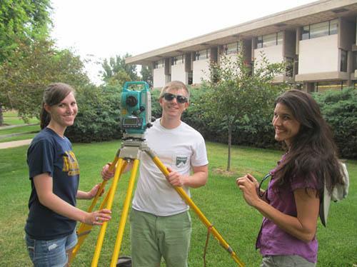 Mastering the total station: (L-R) Hannah Moore, Kelton Meyer, Susan Kuznik.