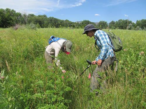 Metal detector survey at the Camp Collins site: (L-R) Kate Eastep, Susan Kuznik.