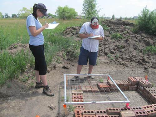 Drawing features at the Poudre Learning Center test site: Carlye Schaeffer and Jack Fuqua.