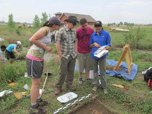 Determining soil color at the Poudre Learning Center test site: (L-R) Carlye Schaeffer, Kelton Meyer, Connor Blum, Susan Kuznik.