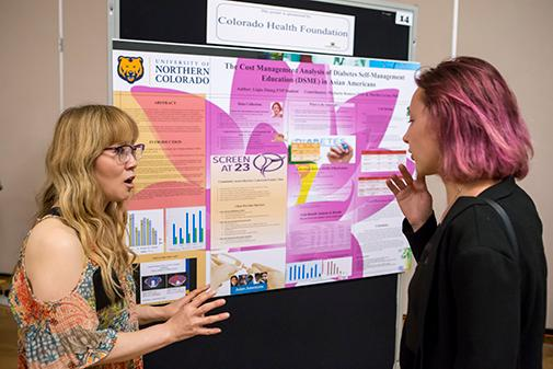NHS Student presenting their research to a guest