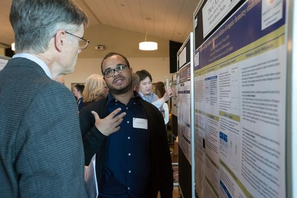 Gary talking to poster presenter Lidiak