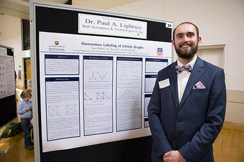 NHS Student with their research