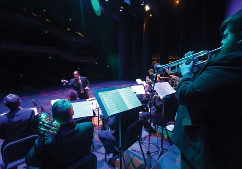 Professor Socrates Garcia conducts his Latin Jazz Orchestra. Photo by Woody Myers
