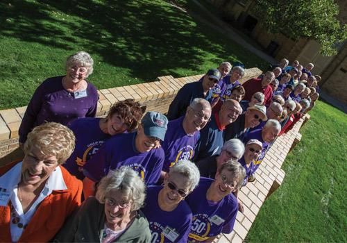 The Class of 1965 gathers on Hi Bridge in celebration of their 50th Reunion during Homecoming Weekend.
