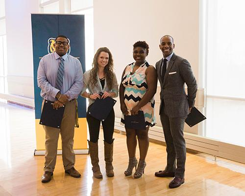 Africana Studies program student recognition award winners with faculty member Dr. Travis Boyce