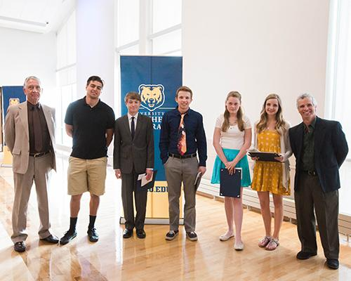Geography & GIS program student recognition award winners with faculty members Dr. Charles Collins and Dr. James Dunn
