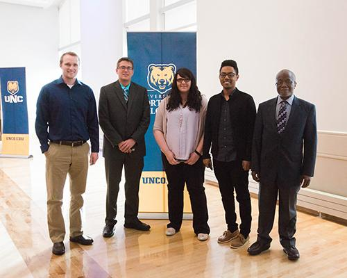 Economics program student recognition award winners with faculty member Dr. Kelfala Kallon