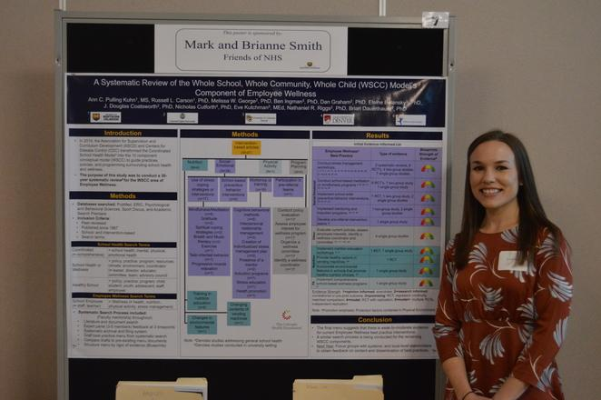 Sport and Exercise Science Major with her poster