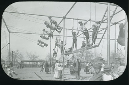 Early photograph of young children playing on a playground