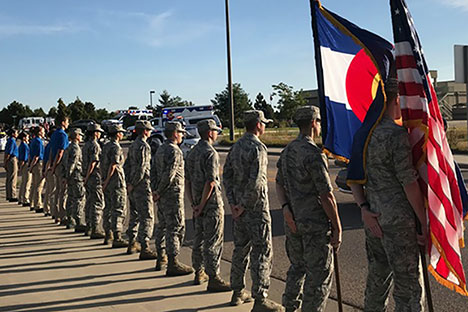 Cadets holding American and Colorado flags.