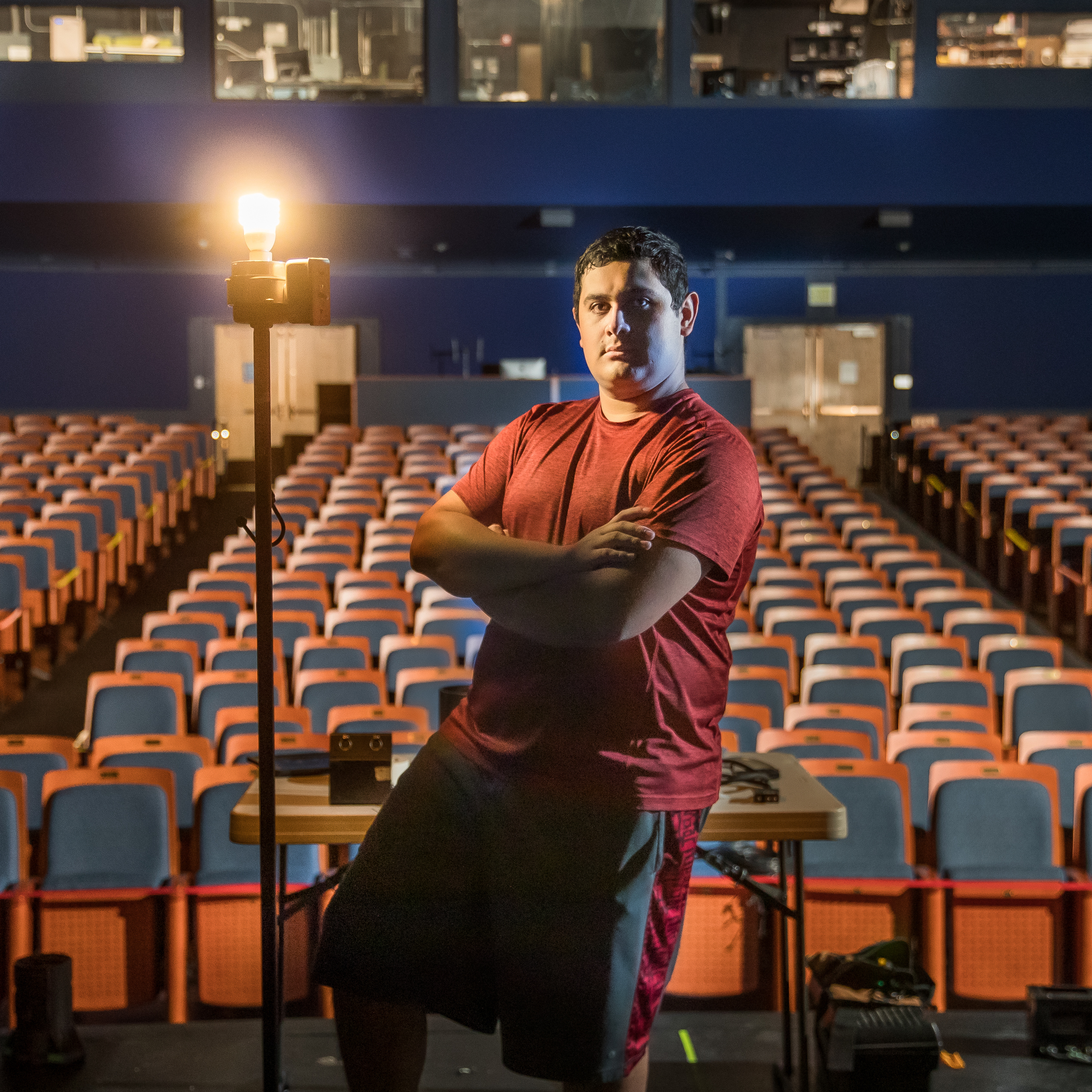 Theatre student Arteaga stands on stage before empty theater
