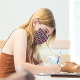 Student in class masked and socially distant