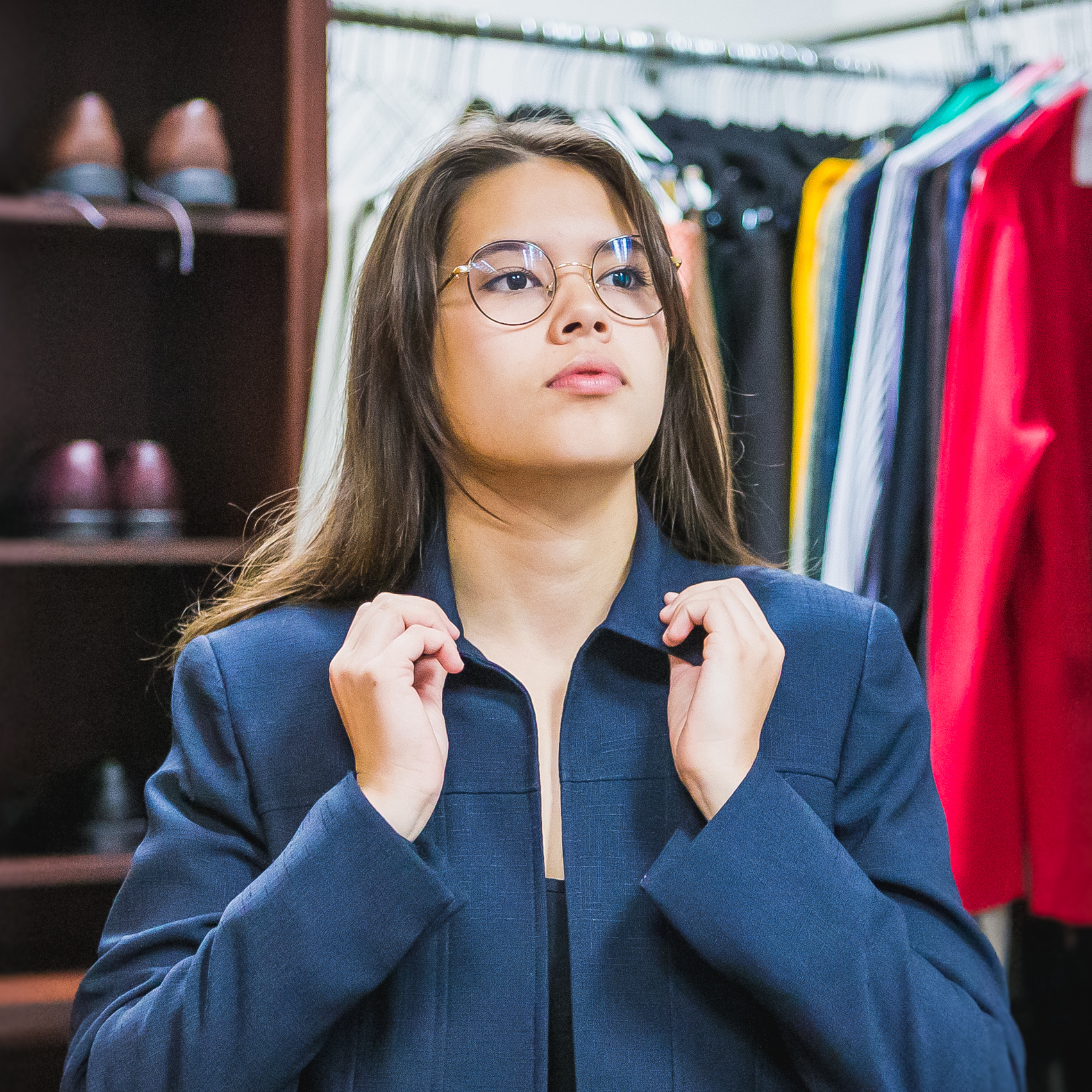 Student tries on blazer in UNC's Professional Attire Closet.