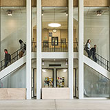 Students walk down symmetrical staircase