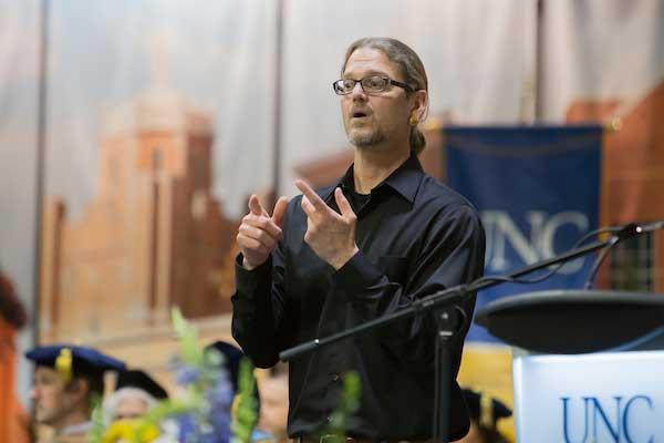 Sign language interpreter signing.