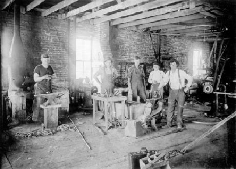 Workers In a Blacksmith Shop