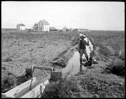 A Farmer Irrigating (1900)
