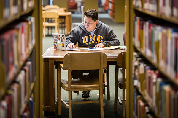 UNC student studying in Michener Library