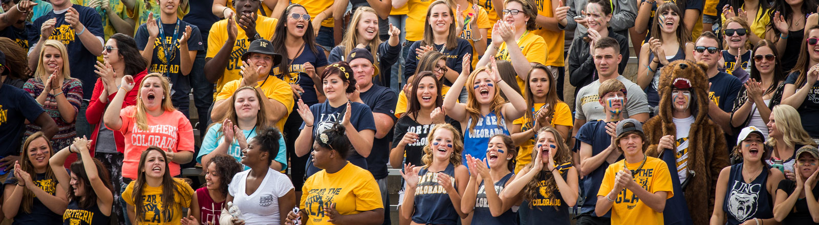 Student cheering at a football game.