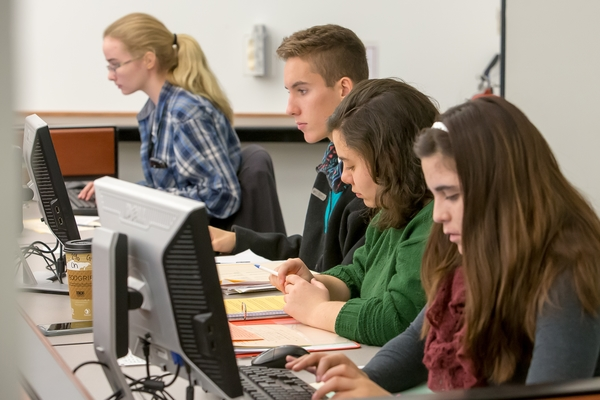 Photo of students working on computers in a Michener Library classroom