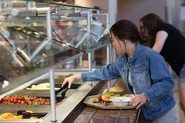 Dining halls feature food stations and salad bar