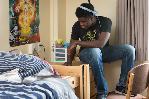 Student in his dorm room in Harrison Hall