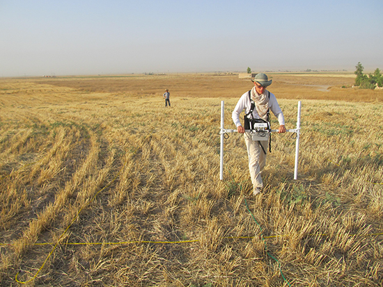 Assistant Professor Andrew Creekmore gathers data from a magnetometer in Iraq
