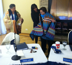 Trustee Dee St. Cyr presents blankets to Carlotta LaNier and Darlene