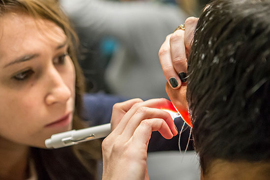 Graduate student Alyssa Lerner customizes an impression using silicon. The impression will be made into a mold that will house an in-canal hearing aid.