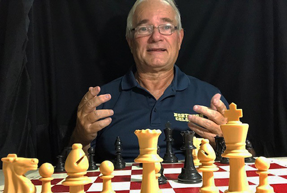 Byron Bridges behind a chess set