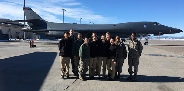 Cadets stand in front of aircraft.