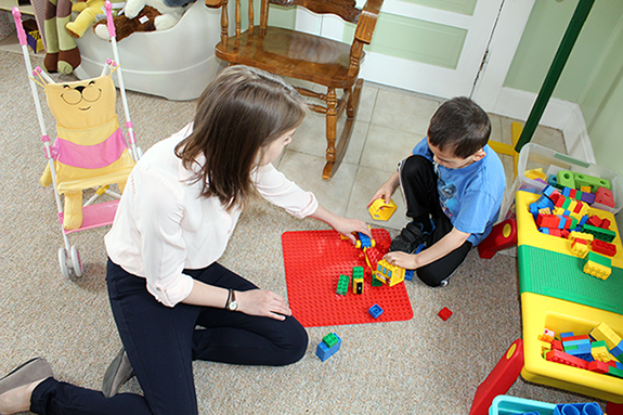 Hannah Breckinridge, a Speech-Language Pathology graduate student, plays with a child